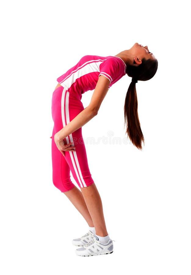 Mujer atractiva joven que hace ejercicio imagen de archivo