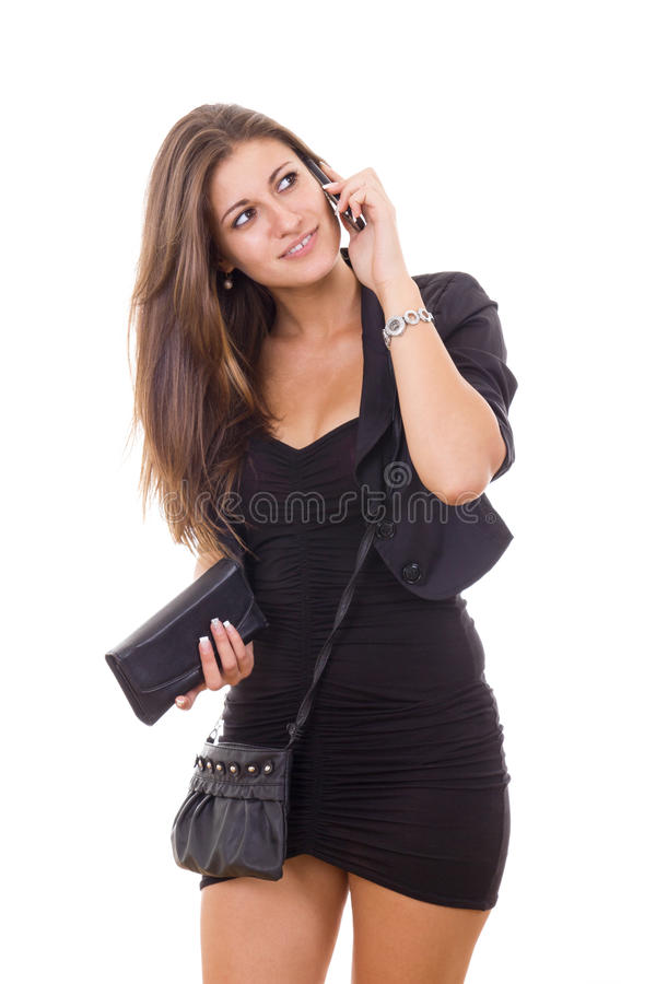 Mujer atractiva que habla en el teléfono imagen de archivo libre de regalías