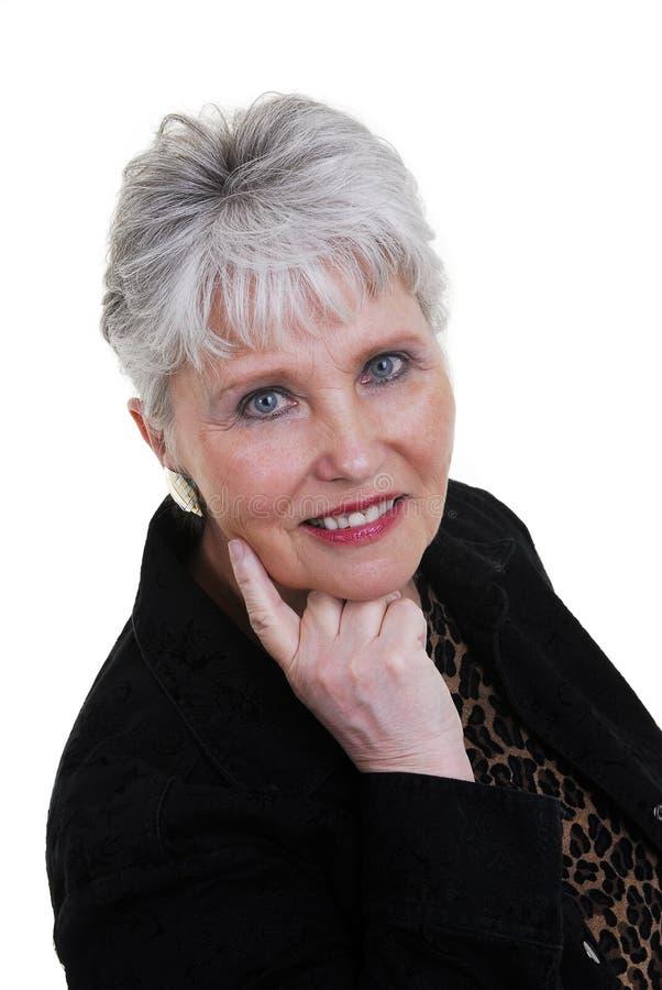 Mujer atractiva sobre 60 imagen de archivo libre de regalías