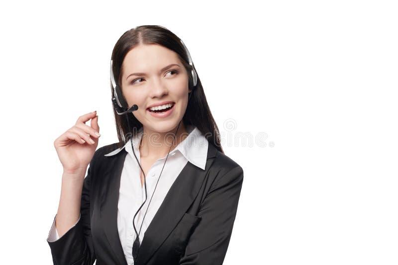 Mujer atractiva sonriente con el auricular foto de archivo