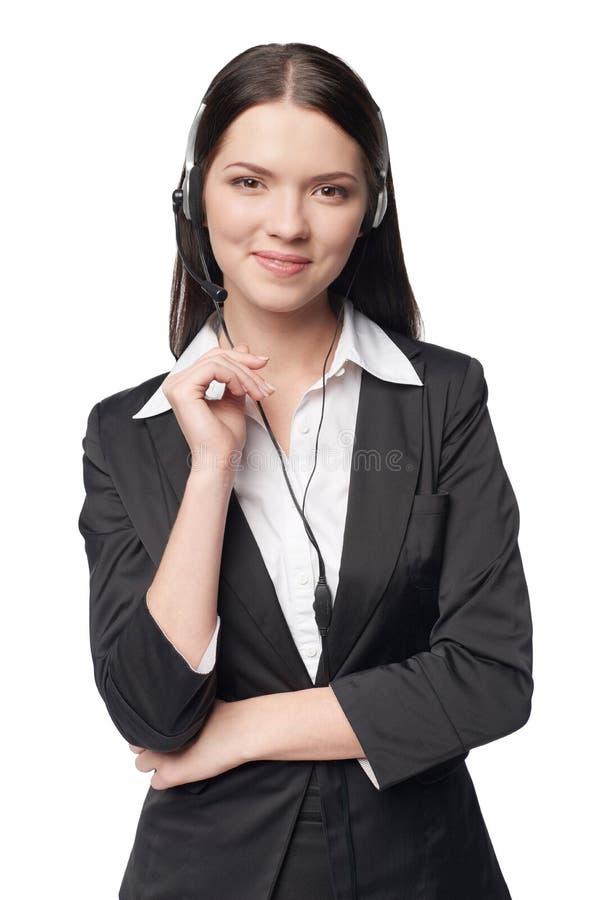 Mujer atractiva sonriente con el auricular imagenes de archivo