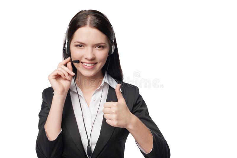 Mujer atractiva sonriente con el auricular fotos de archivo