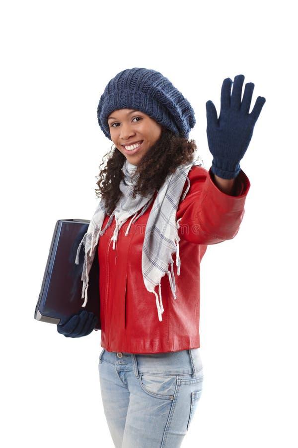 Mujer bastante étnica que agita en el invierno imagen de archivo libre de regalías