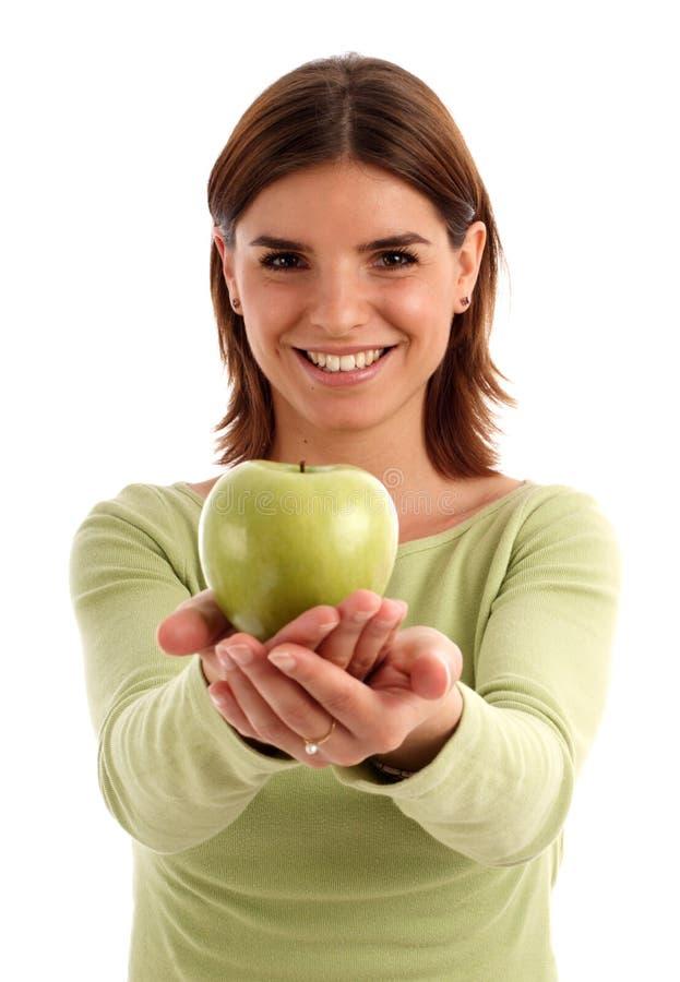 Mujer bastante joven con la manzana verde foto de archivo