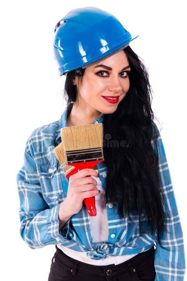 Mujer bastante joven con un cepillo fotos de archivo