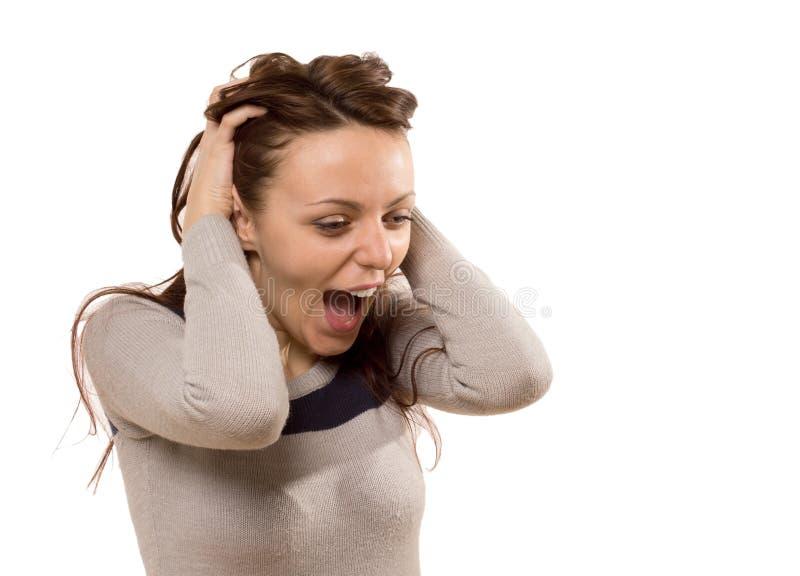 Mujer bastante joven que grita en el entusiasmo imagen de archivo