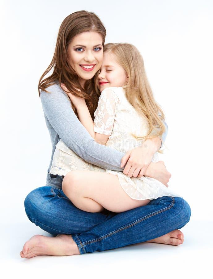 Mujer blanca aislada del fondo con el niño imagen de archivo libre de regalías