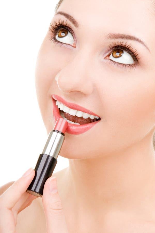 Mujer bonita con el lápiz labial imagen de archivo libre de regalías