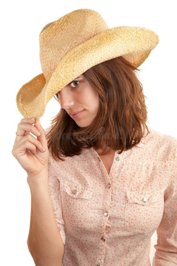 Mujer bonita con el sombrero de vaquero imagen de archivo