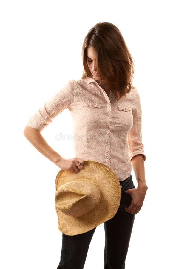 Mujer bonita con el sombrero de vaquero fotografía de archivo