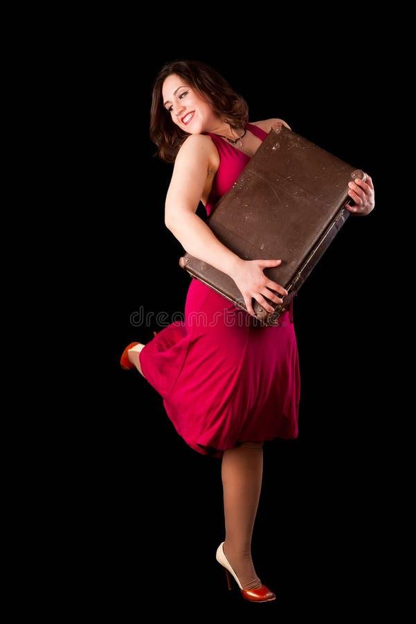 Mujer bonita con la maleta fotografía de archivo