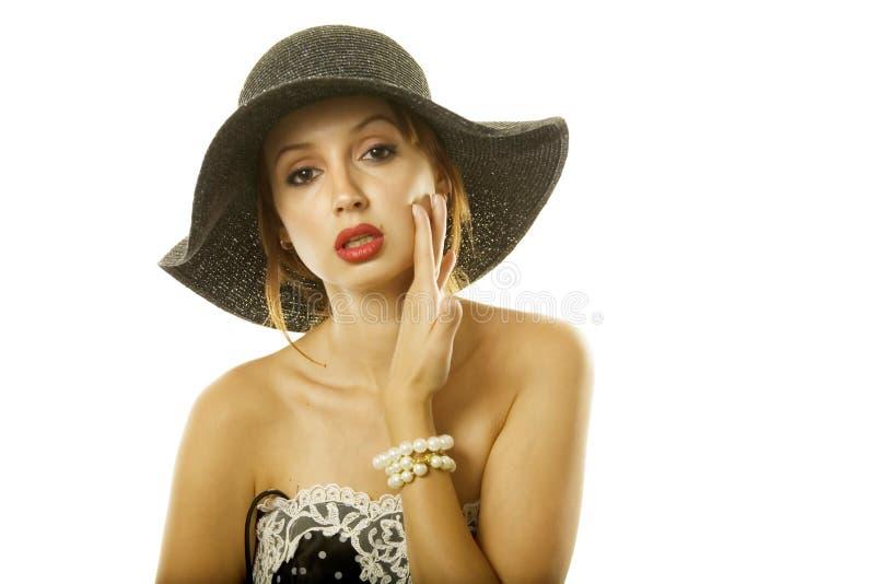 Mujer bonita en sombrero imagen de archivo libre de regalías