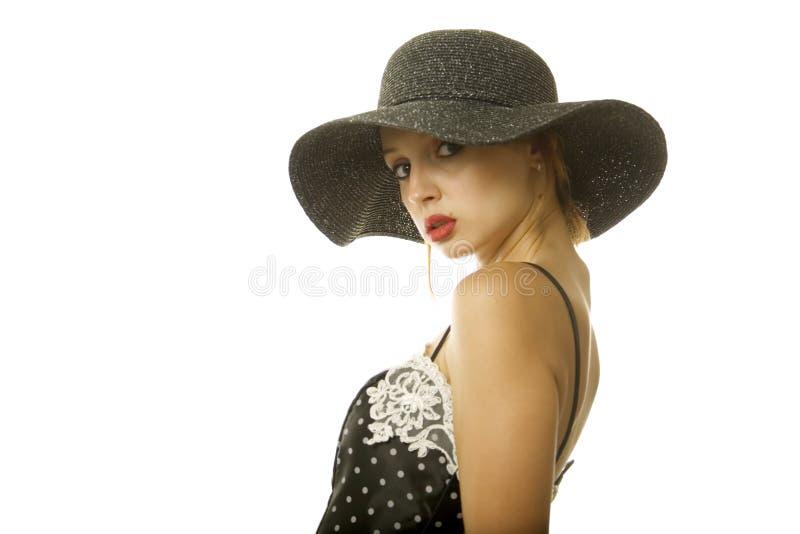 Mujer bonita en sombrero fotos de archivo