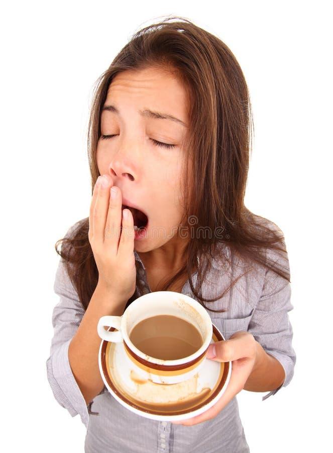 Mujer cansada que bosteza foto de archivo libre de regalías