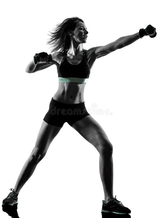 Mujer cardiia de los aeróbicos del ejercicio de la aptitud del entrenamiento de la base de la cruz del boxeo foto de archivo
