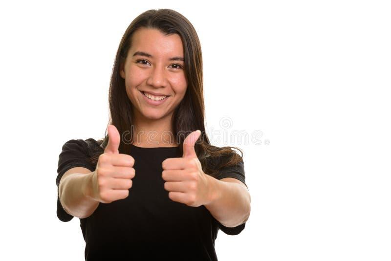 Mujer caucásica feliz joven que sonríe y que da los pulgares para arriba imagen de archivo