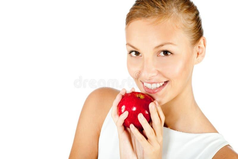 Mujer con Apple rojo imagen de archivo libre de regalías