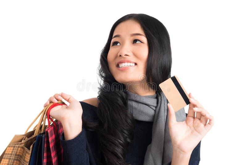 Mujer con de la tarjeta de crédito fotos de archivo
