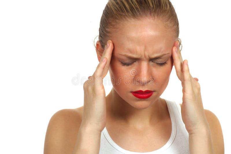 Mujer con dolor de cabeza fotos de archivo