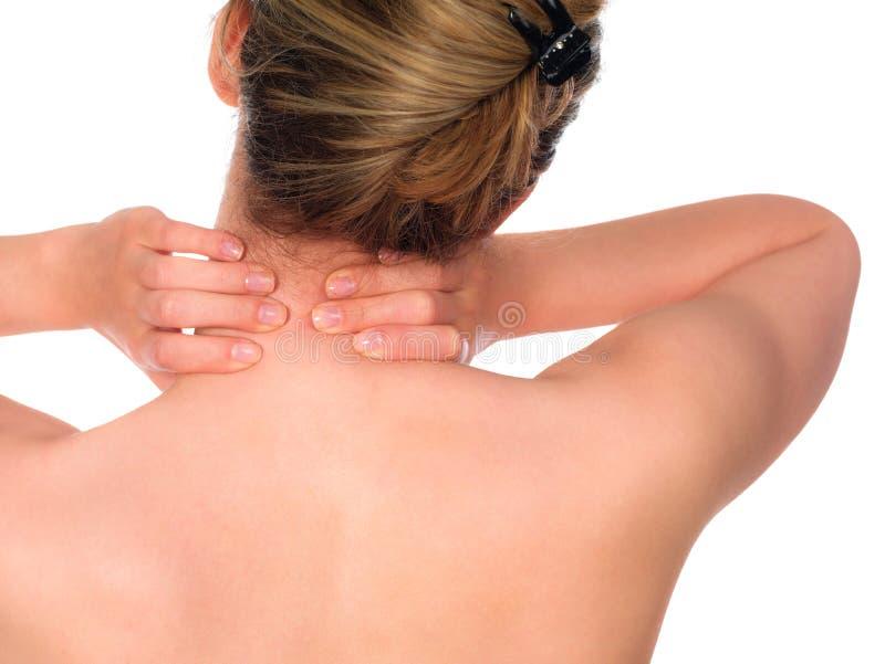 Mujer con dolor de cuello fotografía de archivo libre de regalías