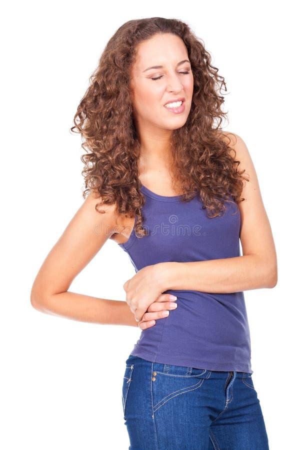 Mujer con dolor de espalda foto de archivo