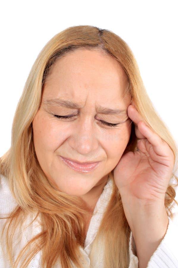 Mujer con dolor del dolor de cabeza de tensión fotografía de archivo libre de regalías