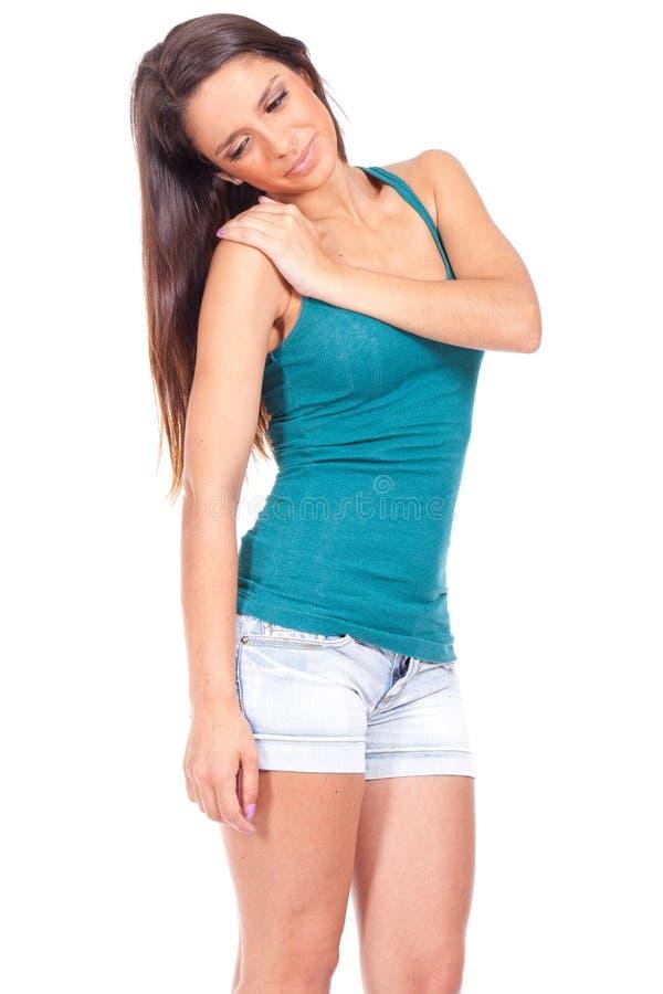 Mujer con dolor del hombro imagen de archivo
