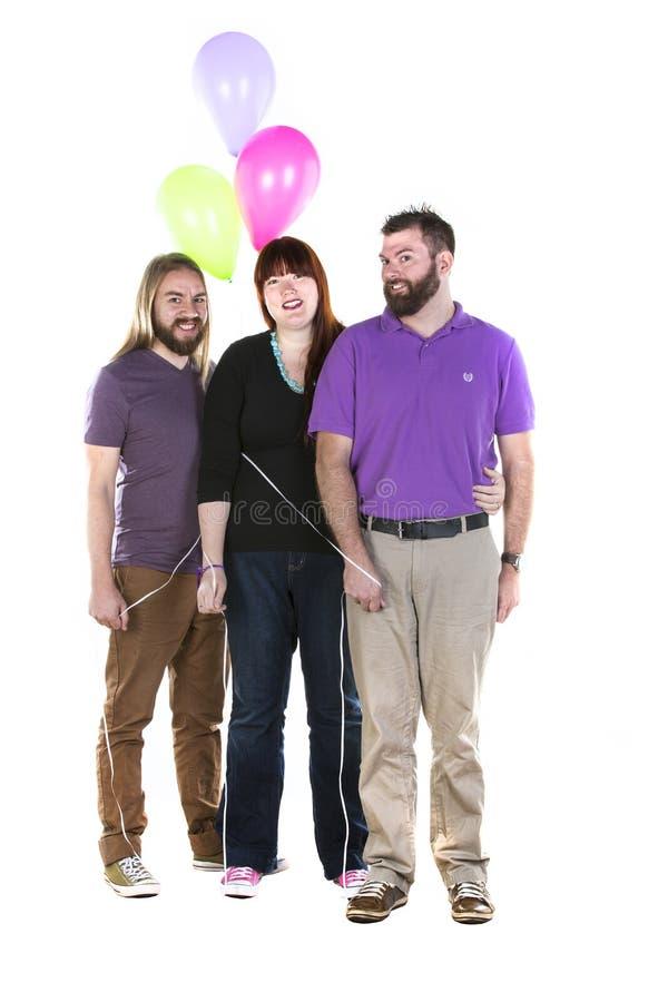Mujer con dos hombres imagen de archivo libre de regalías