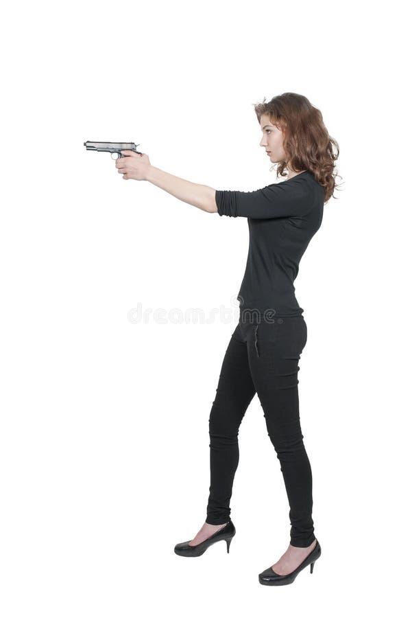 Mujer con el arma fotos de archivo libres de regalías