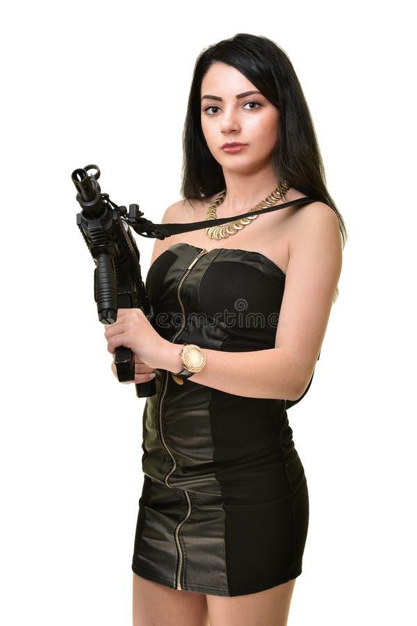 Mujer con el arma imagen de archivo libre de regalías