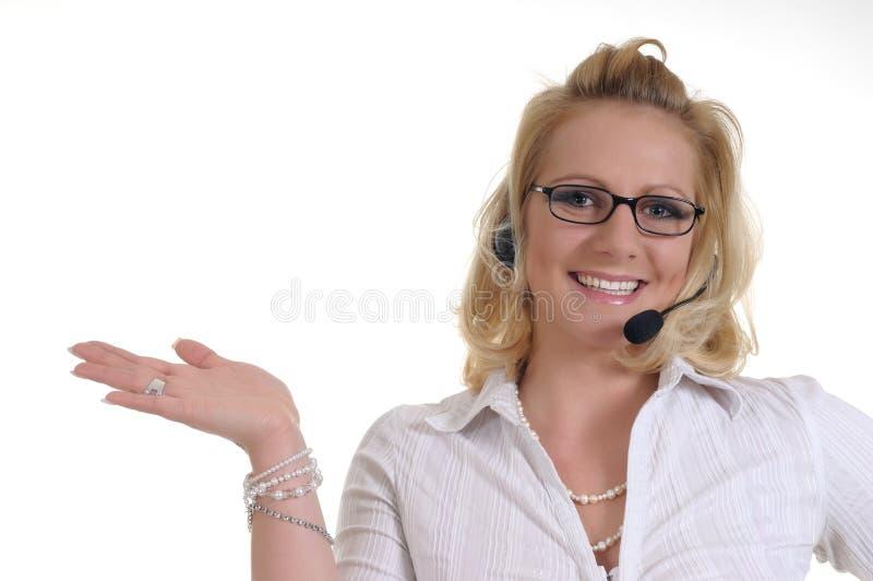 Mujer con el auricular foto de archivo