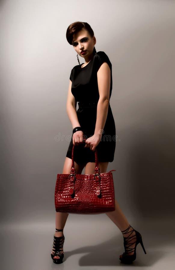 Mujer con el bolso fotografía de archivo libre de regalías