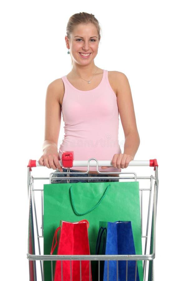 Mujer con el carro de compras foto de archivo
