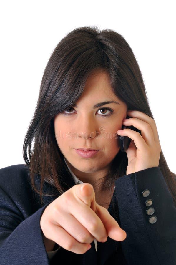 Mujer con el dedo que señala en usted fotografía de archivo