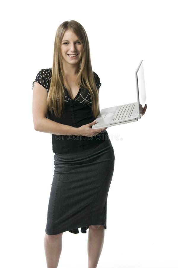 Mujer con el ordenador portátil fotos de archivo