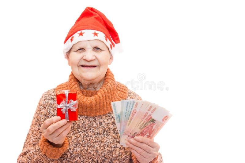 Mujer con el regalo y el dinero fotografía de archivo