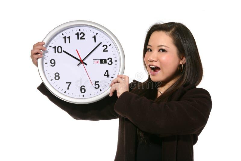 Mujer con el reloj imagen de archivo