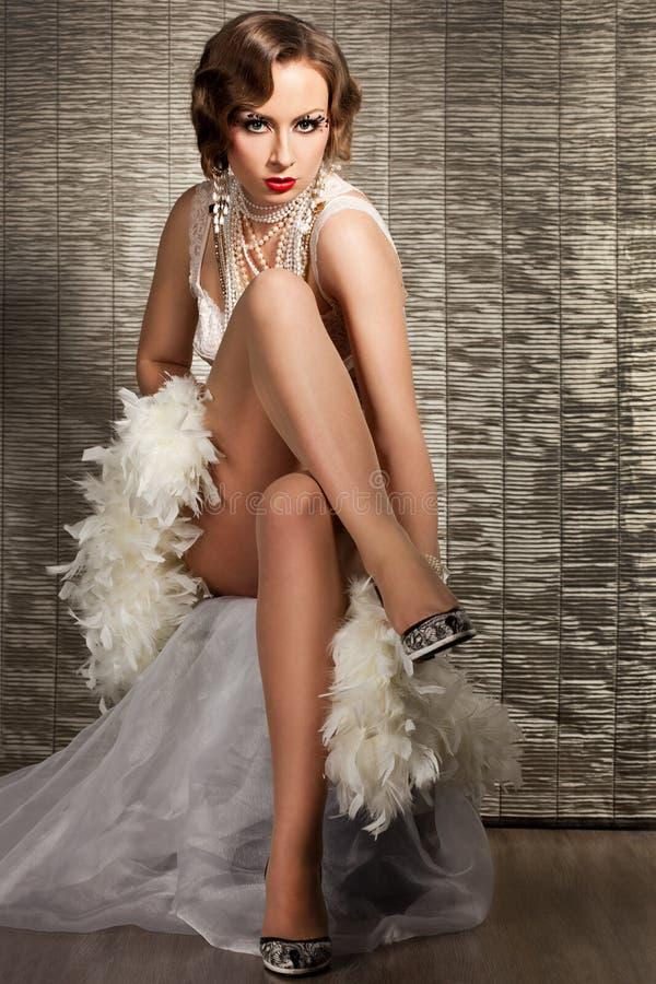 Mujer con el rostro del arte - burlesque fotos de archivo
