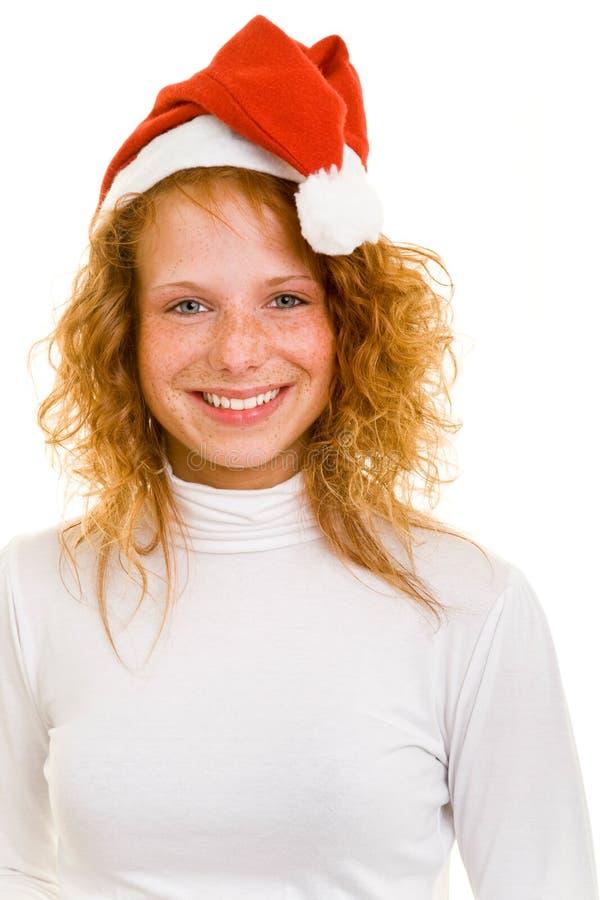 Mujer con el sombrero de la Navidad imagenes de archivo