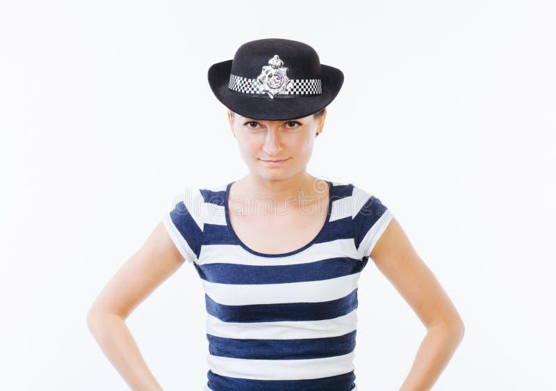 Mujer con el sombrero de la policía fotografía de archivo