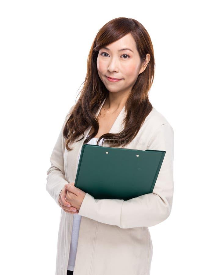 Download Mujer con el sujetapapeles foto de archivo. Imagen de asimiento - 42442152
