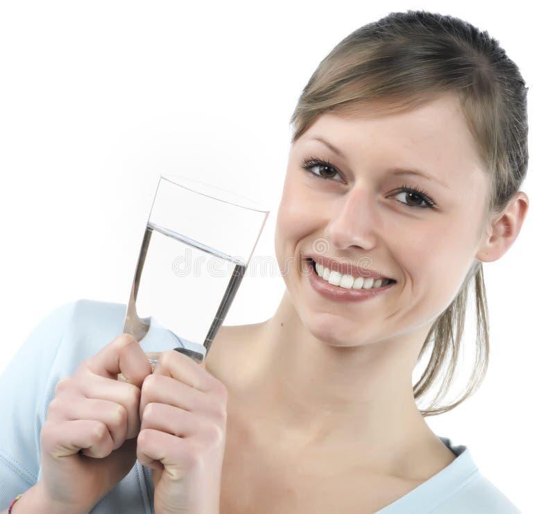 mujer con el vidrio de agua imagen de archivo