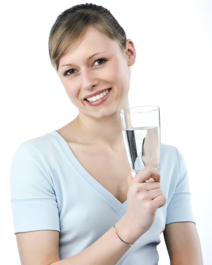 Mujer con el vidrio de agua fotografía de archivo