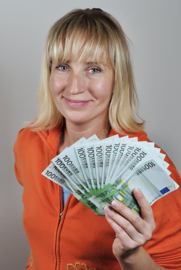 Mujer con euro fotos de archivo libres de regalías