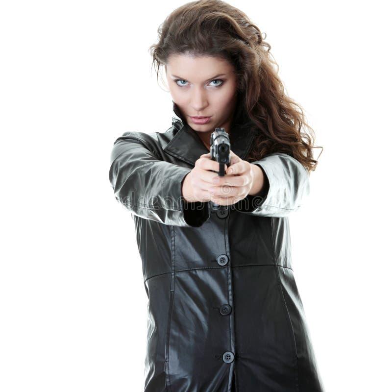 Mujer con la arma de mano foto de archivo