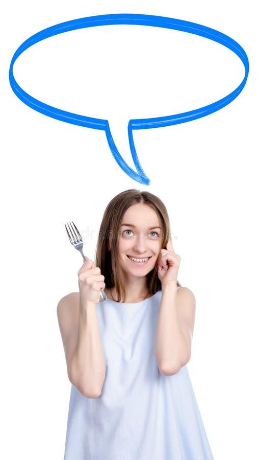 Mujer con la bifurcación a disposición que piensa en la comida imágenes de archivo libres de regalías