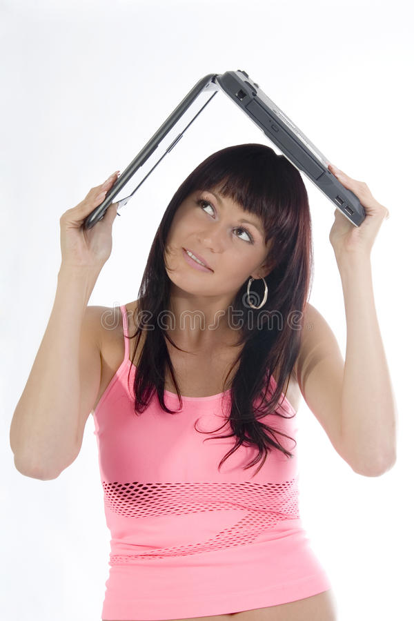 Mujer con la computadora portátil de arriba. fotografía de archivo