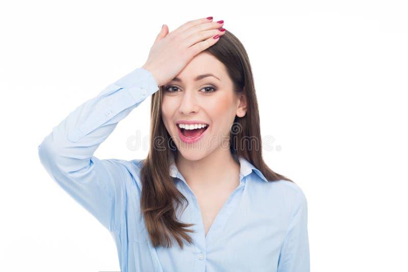 Mujer con la mano en la cabeza fotografía de archivo
