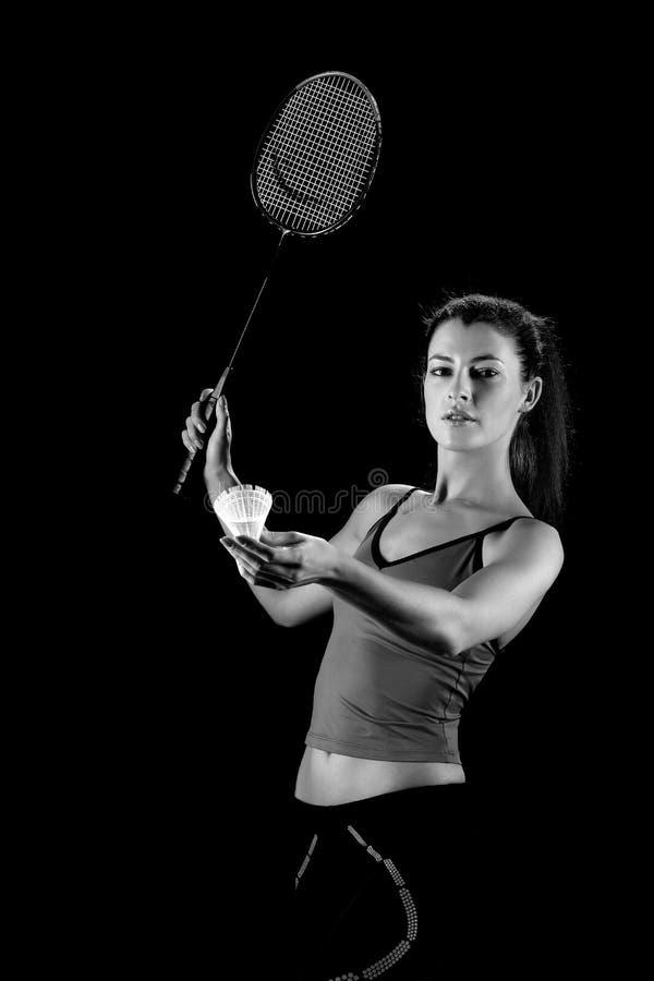 Mujer con la raqueta de bádminton foto de archivo libre de regalías