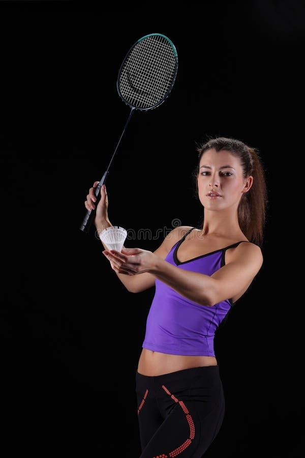 Mujer con la raqueta de bádminton fotografía de archivo